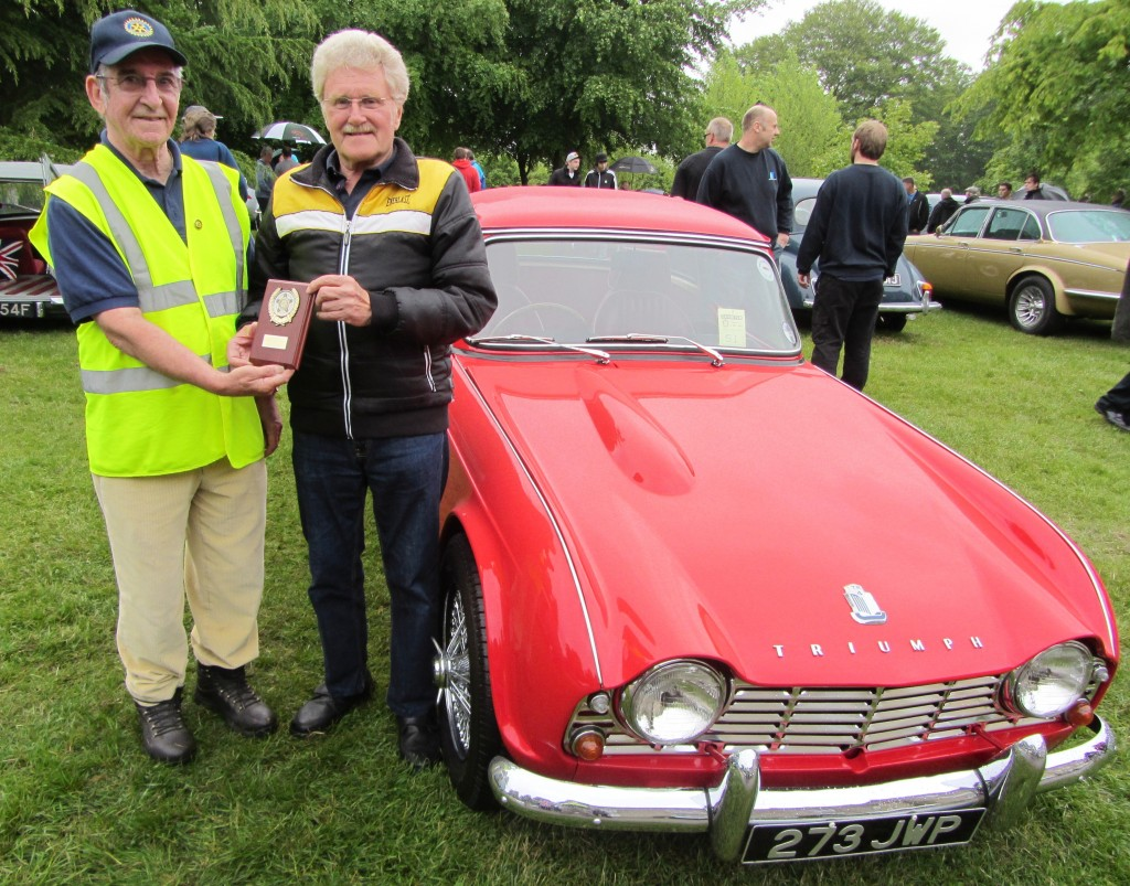2013 winner as voted by the exhibitors, Colin Payne of Mansfield Woodhouse with his superb 1963 2.2 litre Triumph TR4, being presented with his trophy by 2013 rotary president Jim Haggarty