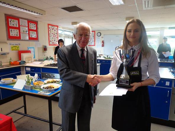 Winner Hannah Parnaby (St Mary's Catholic High School) being presented with the cup by Chesterfield Rotary joint-president David Dolman