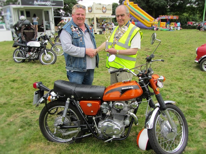 'Best Bike' owner Bill Rimmer (left) being presented with his winning trophy by Chesterfield Rotary president Mike Cudzich-Madry