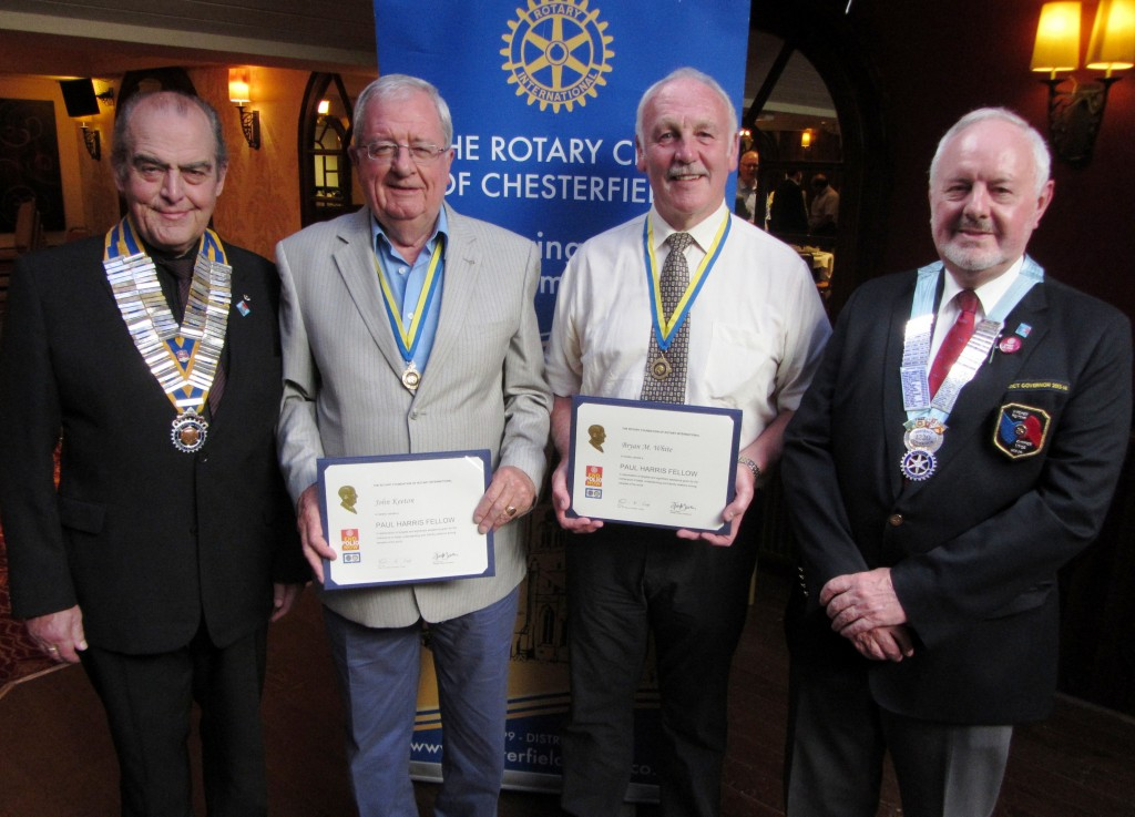 Pictured from left to right: President Mike Cudzich-Madry, Past Presidents & Paul Harris Fellows John Keeton and Bryan White, District Governor Peter Moralee