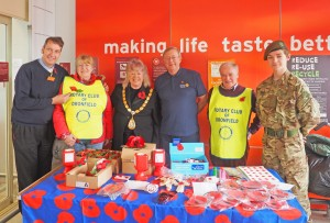 (L to R) Sainsburys Manager, Rotarian Maureen Taylor, Mayor Liz Blanchard, President Brian Simpson, Rotarian Ian McMaster and a member of the Army Cadet Force